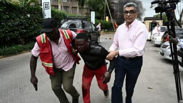 People flee an attack on a hotel in Nairobi Kenya.