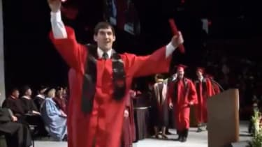 Davenport graduate face-plants on stage after attempting a backflip