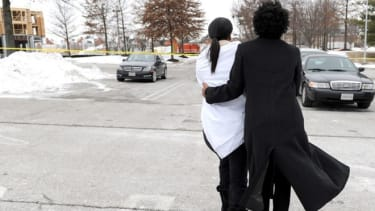 Two women console one another other after the shooting at the Columbia Town Center Mall.