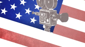 A movie camera and an American flag.