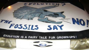 The hood of a car advertises its owner's creationist beliefs: If a new bill passes in Texas, universities would be barred from discriminating against those who reject evolution.