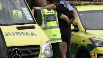 First responders help a man injured during a shooting in Christchurch.