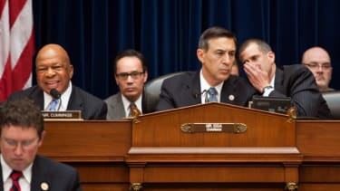 Darrell Issa, R-Ca. (center) confers with committee general counsel Stephen Castor (right), during the hearing on Benghazi, May 8.