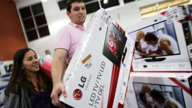 Black Friday shoppers giddily prepare their purchases at a Best Buy in Florida.