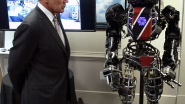 Chuck Hagel meets-and-greets with 6-foot-tall, 330-pound Terminator-like robot