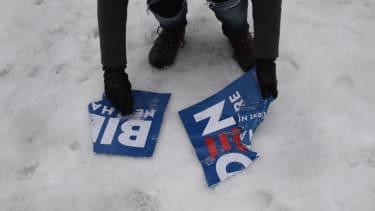 Crumpled Joe Biden sign on the ground.