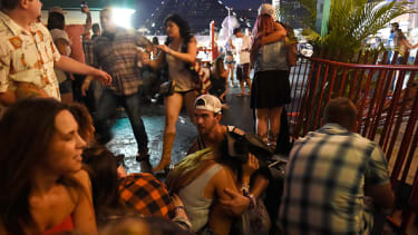 Concertgoers shelter after shooting at the Route 91 Harvest Festival.