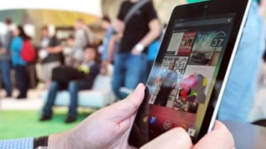 An attendee of Google's Developers Conference uses the new Nexus 7 tablet, which is expected to retail for $199.