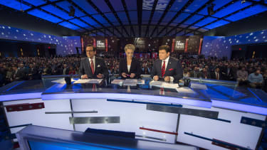 Fox News hosts look on during the Republican Presidential debate sponsored by Fox News at the Iowa Events Center in Des Moines, Iowa on January 28, 2016.