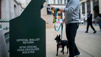 A man drops off his ballot in Philadelphia.