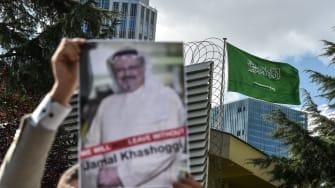 A protestor holds a photo of Jamal Khashoggi outside the Saudi Arabian consulate in Istanbul.
