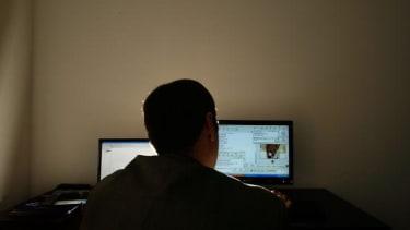 A man on a computer.