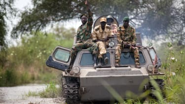 Soldiers of the Sudan People Liberation Army cross the Nile River on a tank near Malakal, northern South Sudan.