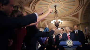 Sen. Mitch McConnell and other Republican senators.