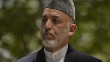 Afghan President Hamid Karzai at a news conference Tuesday confirming the death of his influential half-brother Ahmed Wali Karzai.