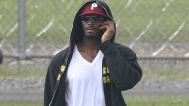 Former New York Giant Plaxico Burress leaves a New York state prison Monday, after a 20-month stint for carrying a loaded gun in a Manhattan nightclub.