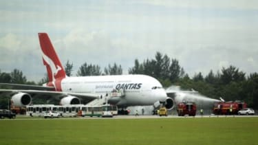 A Qantas A380 makes a safe emergency landing in Singapore after suffering engine failure just after take off.