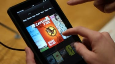 The new Kindle Fire HD is tested at a press conference on Sept. 6: Amazon's budget-friendly tablet may put pressure on competitors to lower their prices, too.