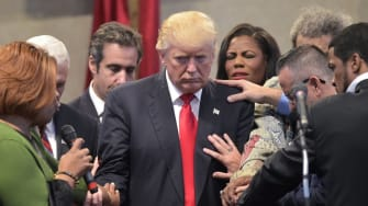 Trump is prayed over at an evangelical meeting