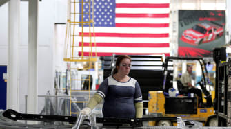 A worker at a car factory.