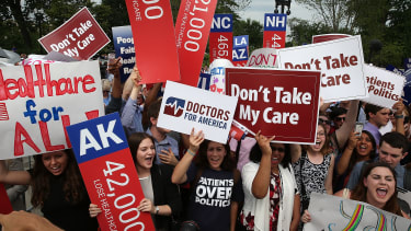 ObamaCare supporters cheer in front of the Supreme Court building