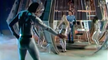 """Tom Jones performs """"Fly Me to the Moon"""" in 1969, in a space suit"""