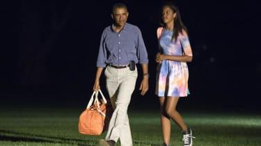 Obama is back in Washington from vacation to address Iraq, Ferguson