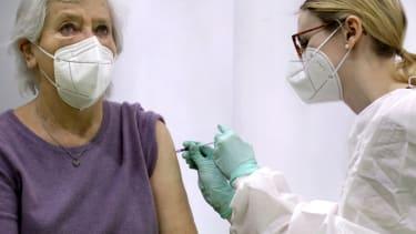 A woman receives a coronavirus vaccine.