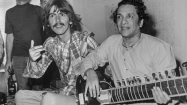 George Harrison with Indian musician Ravi Shankar in August 1967: Harrison and Shankar organized the Concert for Bangladesh, the first rock star charity performance of its kind.