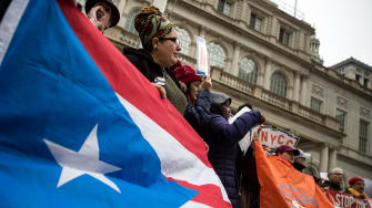 Activists rally in support of Puerto Rican families.