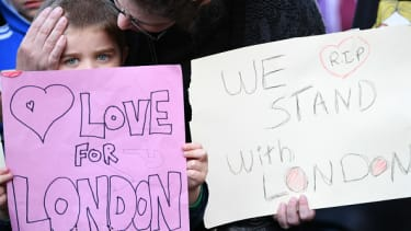 People hold signs supporting London.