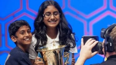Snigdha Nandipati, 14, of San Diego, Calif., is hugged by her brother, Sujan, 10, after she won the 85th Annual Scripps National Spelling Bee.