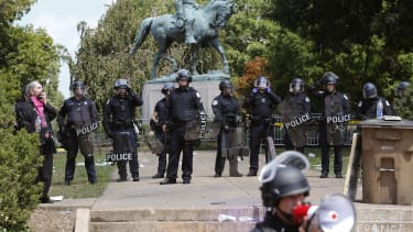 Virginia State Police in riot gear guard Lee Park after a white nationalist demonstration was declared illegal in Charlottesville.