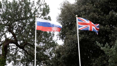 Russian and UK flags.