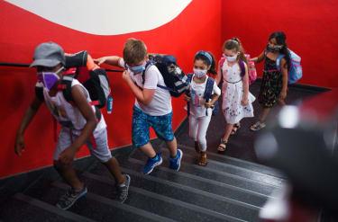 Children wearing masks.