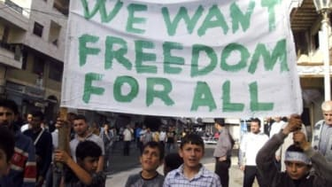 Syrian protesters called for greater freedoms on Sunday, one day after President Bashar Al-Assad promised to lift a repressive 48-year-old emergency law.