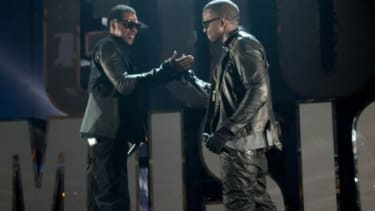 Chart-toping hip-hop artists Jay-Z (left) and Kanye West
