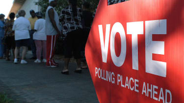 A sign points to a polling station