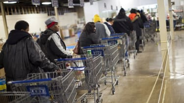 Shoppers wait in line to shop for food at the St. Vincent de Paul food pantry in Indianapolis, Indiana.