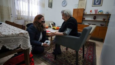 Holocaust survivor Miriam Linia receives assistance in Haifa.