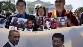 Protesters rally for Chinese political dissidents before President Xi Jinping's state visit