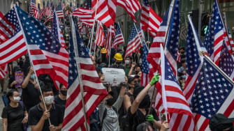 Hong Kong protesters march on U.S. consulate.