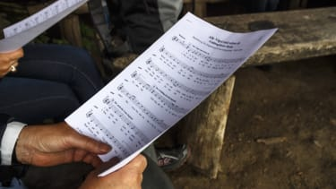 A person holds sheet music.