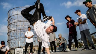 """Jong Ho """"Leon"""" Kim of Korea performs as the other B-Boys watch on during a video production prior to this weekend's Red Bull BC One breakdancing world final, on November 11, 2015 in Rome, Ita"""