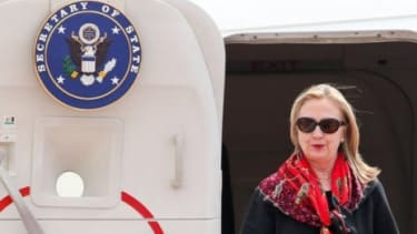 Secretary of State Hillary Clinton arrives at Don Muang International Airport on Nov. 18 in Bangkok, Thailand. President Obama has asked Clinton to leave a summit in Asia to mediate the escal
