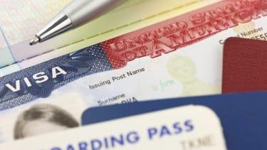 Visa and boarding pass.
