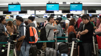 Travelers at the Hong Kong International Airport on Wednesday.