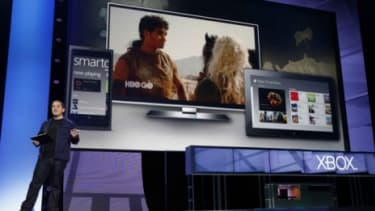 An Xbox executive presents Microsoft's SmartGlass, an app that lets you transfer that Game of Thrones episode you're watching on your tablet to your TV with just one tap.