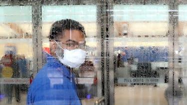 A worker wearing a mask