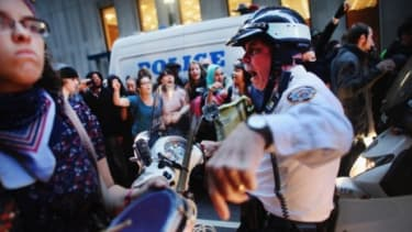 New York City police and Occupy Wall Street protesters face off: One conspiracy theory about OWS suggests that New York cops are being paid off by big banks.